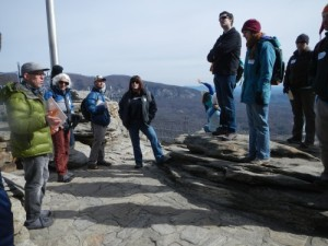 Learning about geology (Anthony Love) on top of Chimney Rock, NC